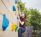 Boy-on-adventure-playground-climbing-wall-3