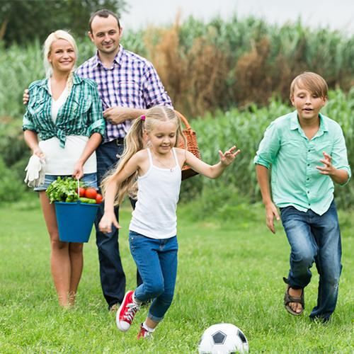 Family in garden with football